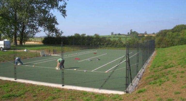 Marking out a tennis court surface