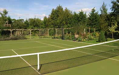 Tennis court built by ETC Tennis Courts Construction Synthetic grass tennis courts, synthetic clay, Macadam, multi use games areas.
