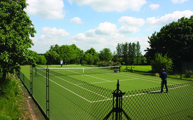 Superb Savanna tennis court surface with obelisk tennis court fencing from Elliott Courts.